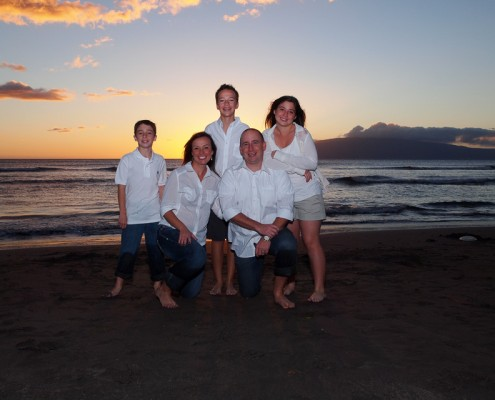 family of five at Launiupoko Beach Park on the west side of Maui, Hawaii