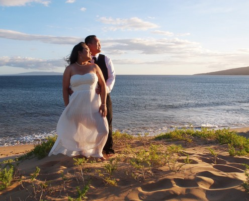 Couple Looking At Sunset, Maui, Hawaii