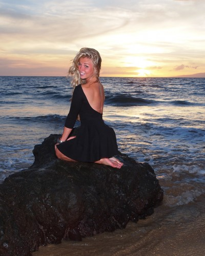 Portrait Photo on Beach at Sunset with a woman dressed in black