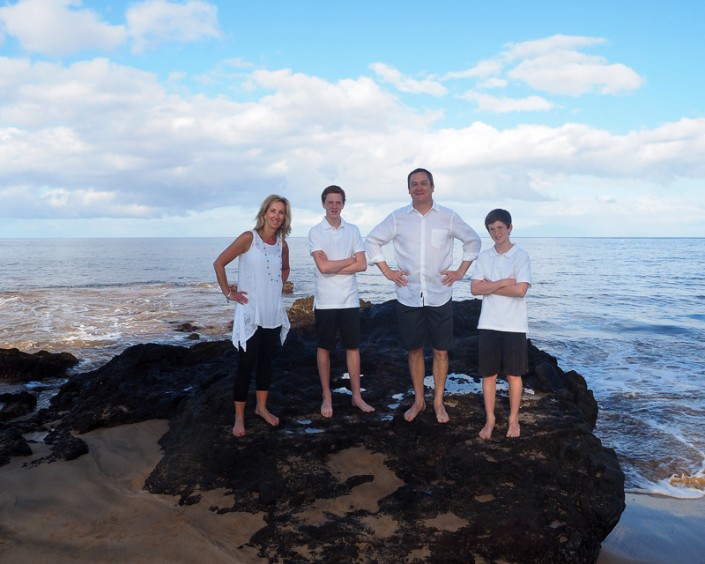 family of 4 on lava rock