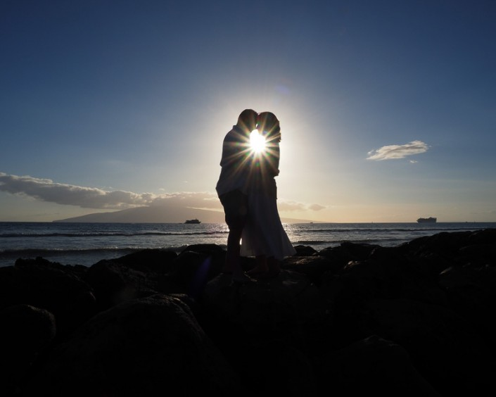 couple in silhouette by sunset