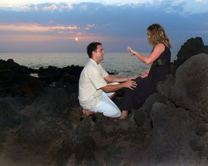 woman admires her engagement ring at marriage proposal
