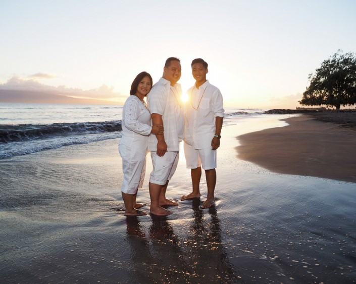 family in white at sunset