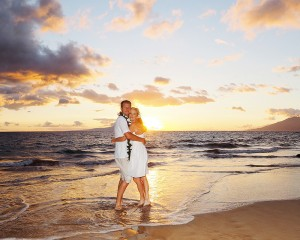 couple on beach at sunset after vow renewal ceremony