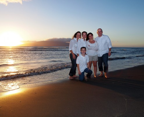 family at sunset picture on a beach in Maui, Hawaii