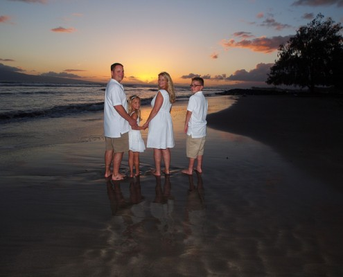Family sunset at Launiupoko Beach Park, Maui, Hawaii