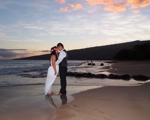 Maui family photography & weddings; couple at sunset on Kealia beach, Kihei, Maui, Hawaii