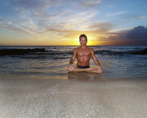 Male Model Showing Lotus Posture on the Beach at Sunset