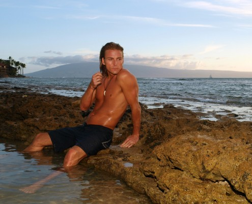 Portrait Photo of Male Model in a casual pose at the shoreline