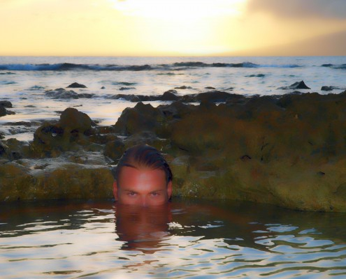 Male Model in Water except for top part of head