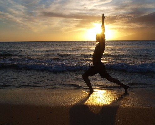 Silhouette Yoga Posture by male model at the beach at sunset