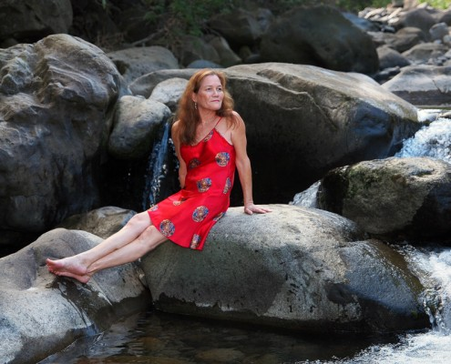 Lady Sitting on Rock at Iao Stream, Maui, Hawaii