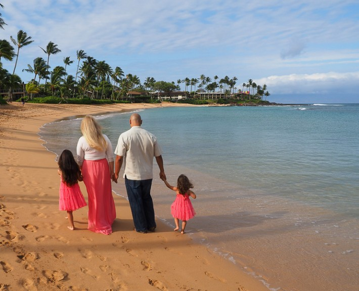 a family walk along the beach