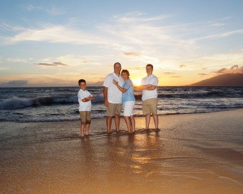 family of four on Maui beach at sunset