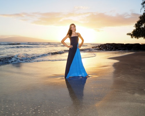 beautiful smiling young lady on maui beach at sunset