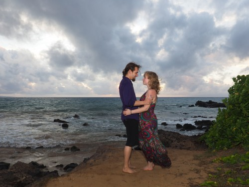 man and woman in love on maui shoreline