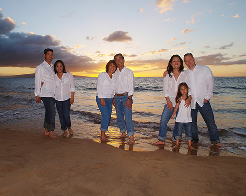 family of 7 on beach at sunset