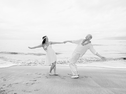 the happy couple are caught in a beach dance