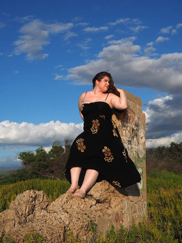 plus size woman standing on old concrete bunker