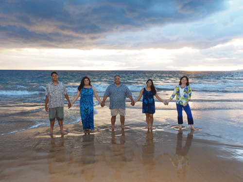 a family of 5 on a Maui beach at sunset posing for a keepsake portrait