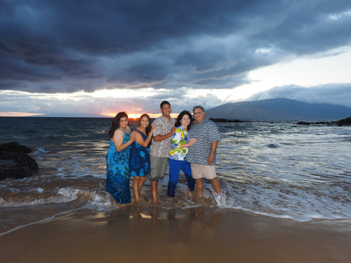 A beautiful family of 5 enjoy a gorgeous sunset on the south shore of Maui