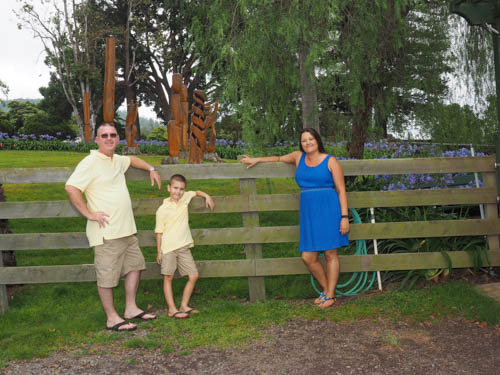 Posed by a fence, a family of 3 enjoys just hanging out in the fresh cool air of upcountry Maui