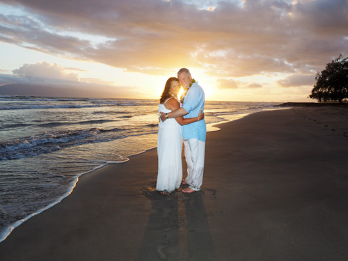 Maui romance photography, a beautiful portrait of a loving couple taken at sunset on a Maui beach