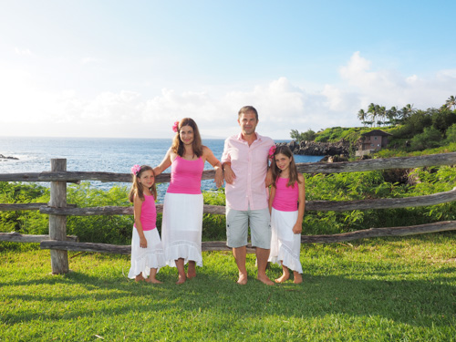 a family of four on the bluff above Kapalua Bay