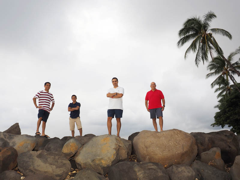 Two dads and two kids on the rocks at the Launiupoko Beach Park breakwall.