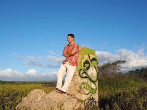 standing atop an old bunker remnant for his senior picture