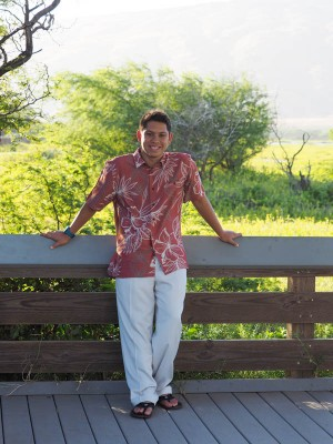 posing for a senior portrait on the island of Maui, Hawaii