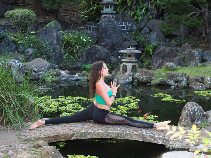 Yoga pose on little bridge at Kepaniwai Park, Iao Valley State Park, Maui, Hawaii