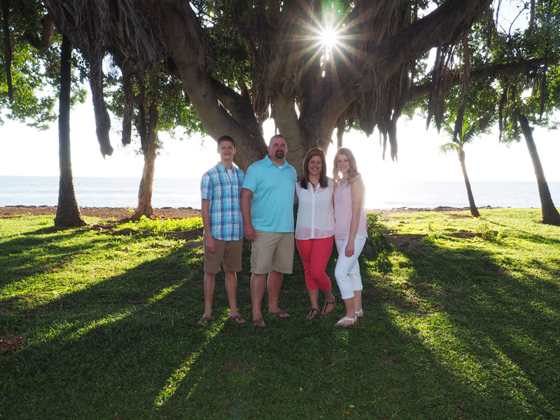 family of 4 under a banyon tree at Maui beach park